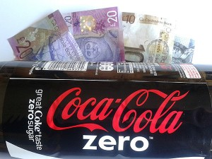 Coca Cola bottle and Cash