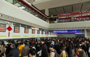 Passengers Queuing at a Railway Station in China
