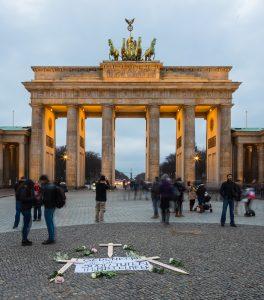 The Brandenburger Tor, Berlin with makeshift Mediterranean refugee memorial