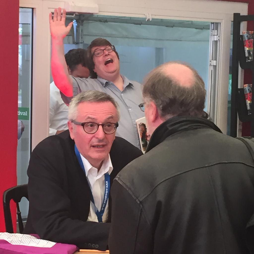 Philosopher, writer and critic of Progressivism and Labour, John Gray, being 'photobombed' at the 2015 Edinburgh International Book Festival.